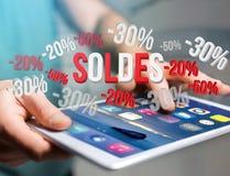Promotion des ventes 20% 30% et 50% volant au-dessus d'une interface - Shopp Images libres de droits