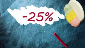 25% promotion discount offer. Appearing after brush wiping on blackboard stock footage