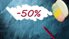 50% promotion discount offer. Appearing after brush wiping on blackboard stock video footage