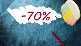 70% promotion discount offer. Appearing after brush wiping on blackboard stock video footage