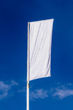 Promotional flag. In white over the sky stock photos