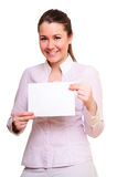 Promotional gift card. Woman showing empty blank paper card sign with copy space for text.  model isolated on white background Royalty Free Stock Photos
