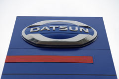 Promotional stand with NISSAN sign near building Nissan service center. Ulyanovsk, Russia - July 20, 2016: Promotional stand with Datsun sign near building stock photography