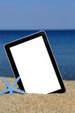 Promotional tablet template. On the beach stock photo