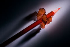 Prompt rise. Red pencil and shaving (on a dark background). It is a metaphor - fast career Vector Illustration