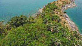 Promthep Cape Cliff Aerial. HD birds eye slowmotion shot. Phuket Island, Thailand. stock video footage