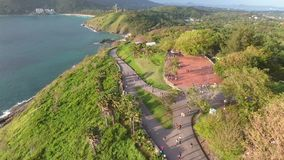 Promthep Cape. Popular Touristic Sunset Viewpoint at Phuket Island, Thailand. Aerial view in 4K. Promthep Cape. Popular Touristic Sunset Viewpoint at Phuket stock video footage