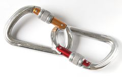Proof connection. Safety connection. Two climbing carabiners isolated royalty free stock images