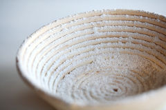 Proofing basket banetton dusted with flour. Used for baking artisan bread Royalty Free Stock Images