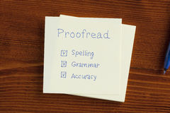 Proofread written on a note Royalty Free Stock Photos