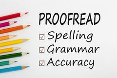 Proofread written on paper sheet. PROOFREAD written on a white background and colour pencils. Business concept Royalty Free Stock Image