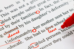 Proofreading english document. Closeup red marks on proofreading english document Stock Image
