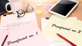 Proofreading paper on table. With office supplies Stock Image