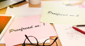 Proofreading paper on table Stock Photo