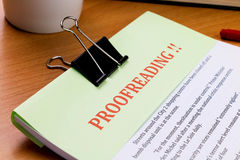 Proofreading red word on green sheet Royalty Free Stock Photos