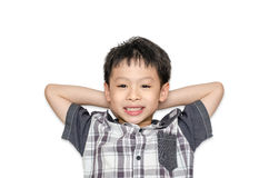 Propósito superior de las sonrisas y de la mentira del muchacho en fondo Imágenes de archivo libres de regalías