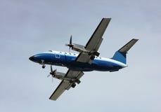 Prop plane landing Royalty Free Stock Photos