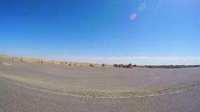 Prop?sito de la conducci?n de autom?viles en la forma de relieve Gansu, China de Yardang metrajes