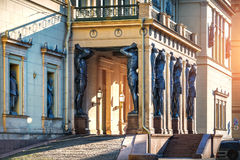 Prop up the firmament. Black sculptures of Atlantis at the entrance to the Hermitage in St. Petersburg Stock Images