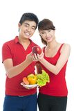 Propaganda of healthy eating. Isolated shot of smiling young people adhering to healthy eating Stock Images