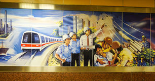 Propaganda on the wall at subway station in Singapore.  royalty free stock images