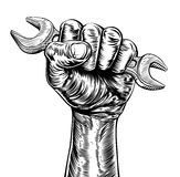 Propaganda Woodcut Fist Hand Holding Spanner Stock Photos