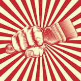 Propaganda Woodcut Paintbrush Fist Hand. An original design of a fist holding a paintbrush in vintage propaganda poster wood cut style Stock Photo