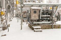 Propane compressor operates in winter conditions Stock Photos