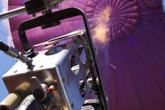 Propane flame in purple hot air balloon. Propane flame shooting upwards in purple hot air balloon Stock Photos