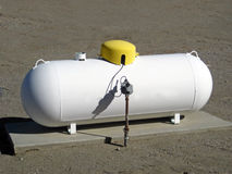 Propane tank. Residential propane tank attached to a pipe Royalty Free Stock Photography