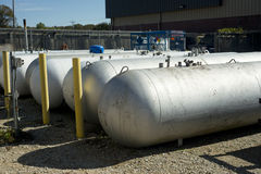 Propane Tanks. At a retail facility await refilling and transport Royalty Free Stock Image