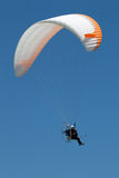 Propelled paraglider on clear sky Stock Photography