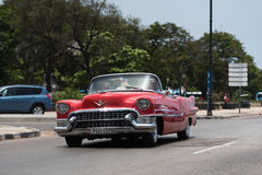 Propelled red cabriolet vintage car on the Malecon.  Royalty Free Stock Image