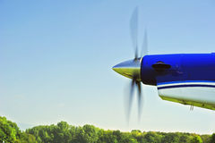 Propeller. The propeller of an aircraft starting up, with motion blur on the blades. Space for text in the sky Stock Images