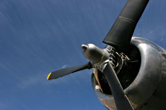 Propeller against blue sky. An old propeller engine stands proud against a soft blue sky stock photography