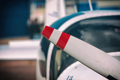Propeller aircraft with a fragment of the fuselage Stock Photography