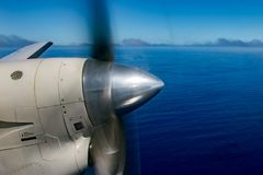 Propeller airplane detail flying in tropical paradise Stock Photo