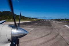 Propeller airplane detail taking off out of tropical paradise Stock Photo