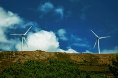 Propeller blades from some wind generators of electric power. Large propeller blades from two wind generators of electric power on hilly landscape at Serra da royalty free stock photo
