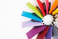 Propeller of colored envelopes on the white desk Stock Photos