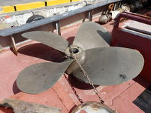 A propeller on the deck of a tug-boat. A large ship's propeller on the deck of a tug-boat in st. vincent and the grenadines Royalty Free Stock Image