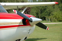 Propeller Engine. Small propeller red and white airplane Stock Image
