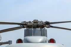 Propeller of grey helicopter of Thai army on blue sky. Background Stock Photos
