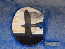 Propeller and keel of an old bluel fishing boat Stock Image