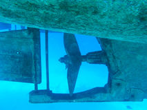 Propeller of metal boat in the red sea. Underwater picture Stock Photo