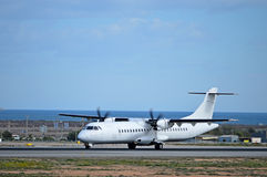 A Propeller Plane Aircraft On Runway Taking Off Stock Photos