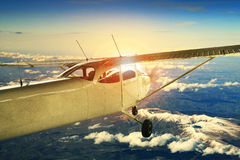 Propeller plane flying over high mountain for traveling theme stock photography