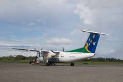 Propeller plane at Honiara airport, Solomon Islands. Honiara, Solomon Islands - May 27, 2015: Small propeller plane parked at the airport Stock Photography