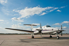 Propeller plane parking at airport Stock Photos