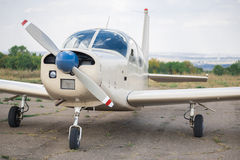 Propeller plane parking at the airport.  Small airplane. Royalty Free Stock Images